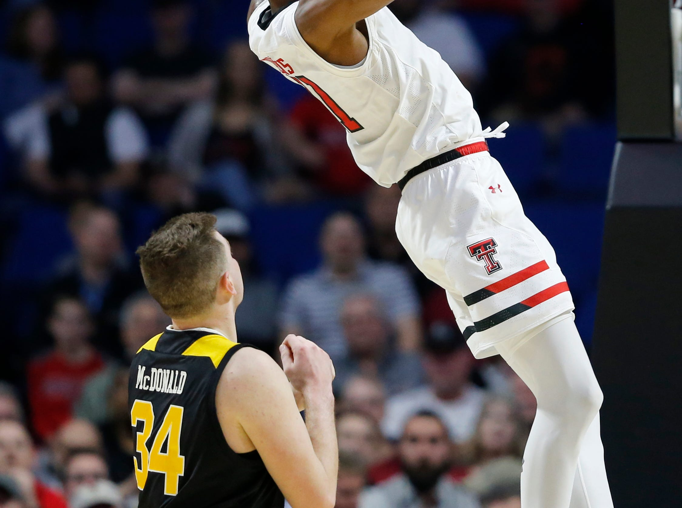Texas Tech Red Raiders forward Tariq Owens (11) throws down a dunk in the first half of the NCAA Tournament First Round game between the 14-seeded Northern Kentucky Norse and the 3-seeded Texas Tech Red Raiders the BOK Center in downtown Tulsa on Friday, March 22, 2019. Texas Tech led 30-26 at halftime.