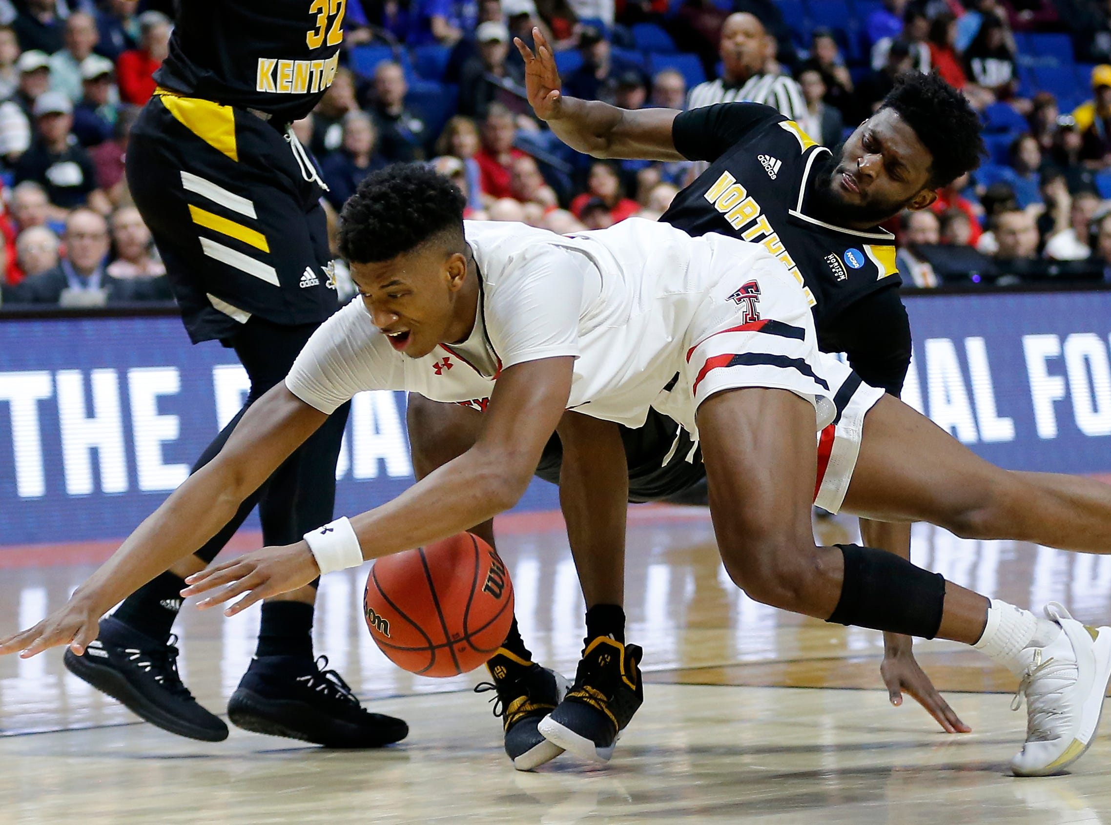 Texas Tech Red Raiders guard Jarrett Culver (23) and Northern Kentucky Norse guard Trevon Faulkner (12) collide over a loose ball in the second half of the NCAA Tournament First Round game between the 14-seeded Northern Kentucky Norse and the 3-seeded Texas Tech Red Raiders the BOK Center in downtown Tulsa on Friday, March 22, 2019. NKU was knocked from the tournament with a 72-57 loss to the Red Raiders.