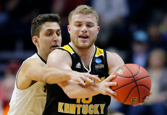 Texas Tech Red Raiders guard Davide Moretti (25) reaches in on Northern Kentucky Norse guard Tyler Sharpe (15) in the second half of the NCAA Tournament First Round game between the 14-seeded Northern Kentucky Norse and the 3-seeded Texas Tech Red Raiders the BOK Center in downtown Tulsa on Friday, March 22, 2019. NKU was knocked from the tournament with a 72-57 loss to the Red Raiders.