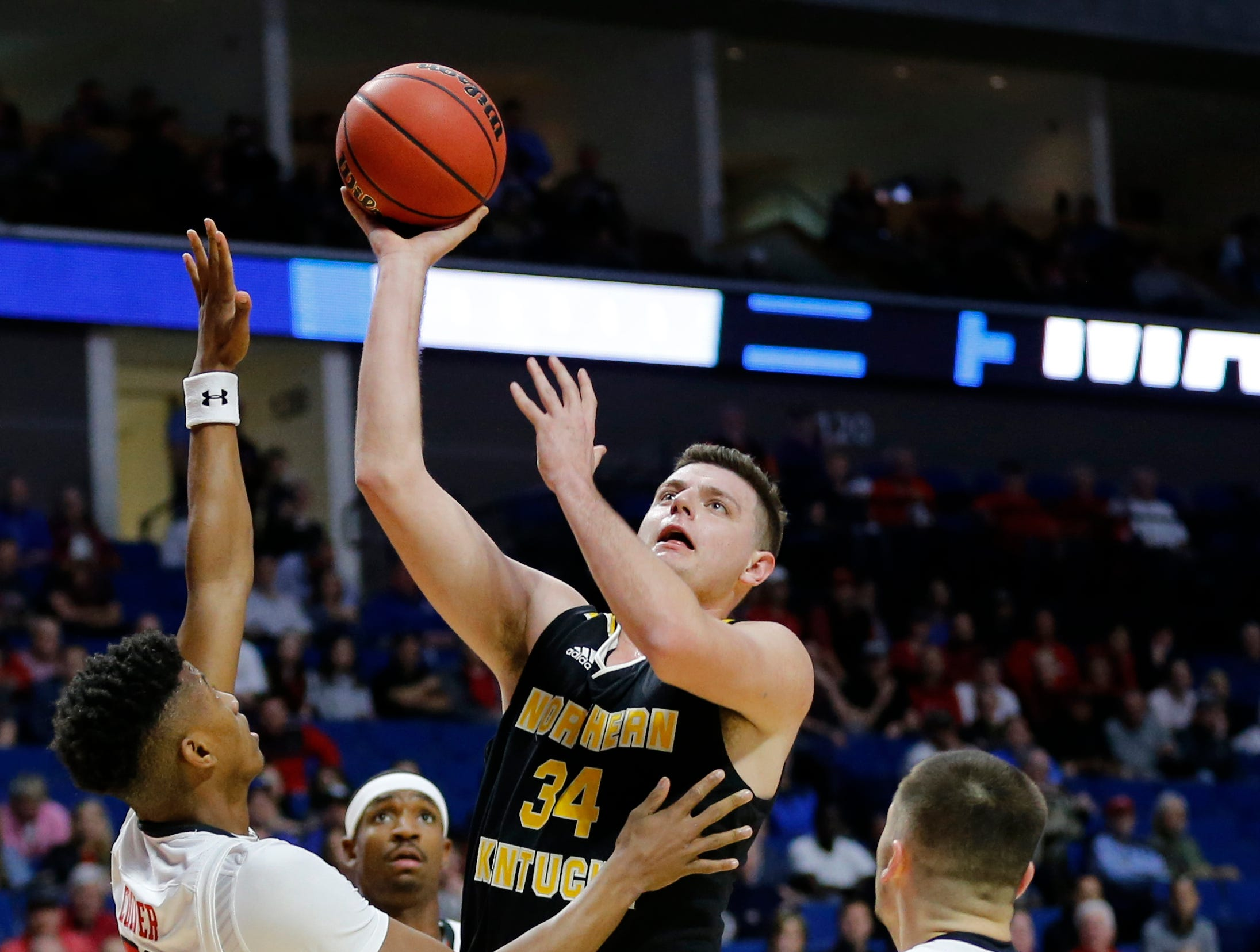 Northern Kentucky Norse forward Drew McDonald (34) attempts a shot in the first half of the NCAA Tournament First Round game between the 14-seeded Northern Kentucky Norse and the 3-seeded Texas Tech Red Raiders the BOK Center in downtown Tulsa on Friday, March 22, 2019. Texas Tech led 30-26 at halftime.