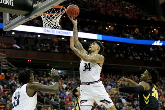 Cincinnati Bearcats guard Jarron Cumberland (34) finishes at the basket in the second half of the NCAA Tournament Round of 64 game against the Iowa Hawkeyes, Friday, March 22, 2019, at Nationwide Arena in Columbus, Ohio. Cincinnati Bearcats lost to the Iowa Hawkeyes 79-72.