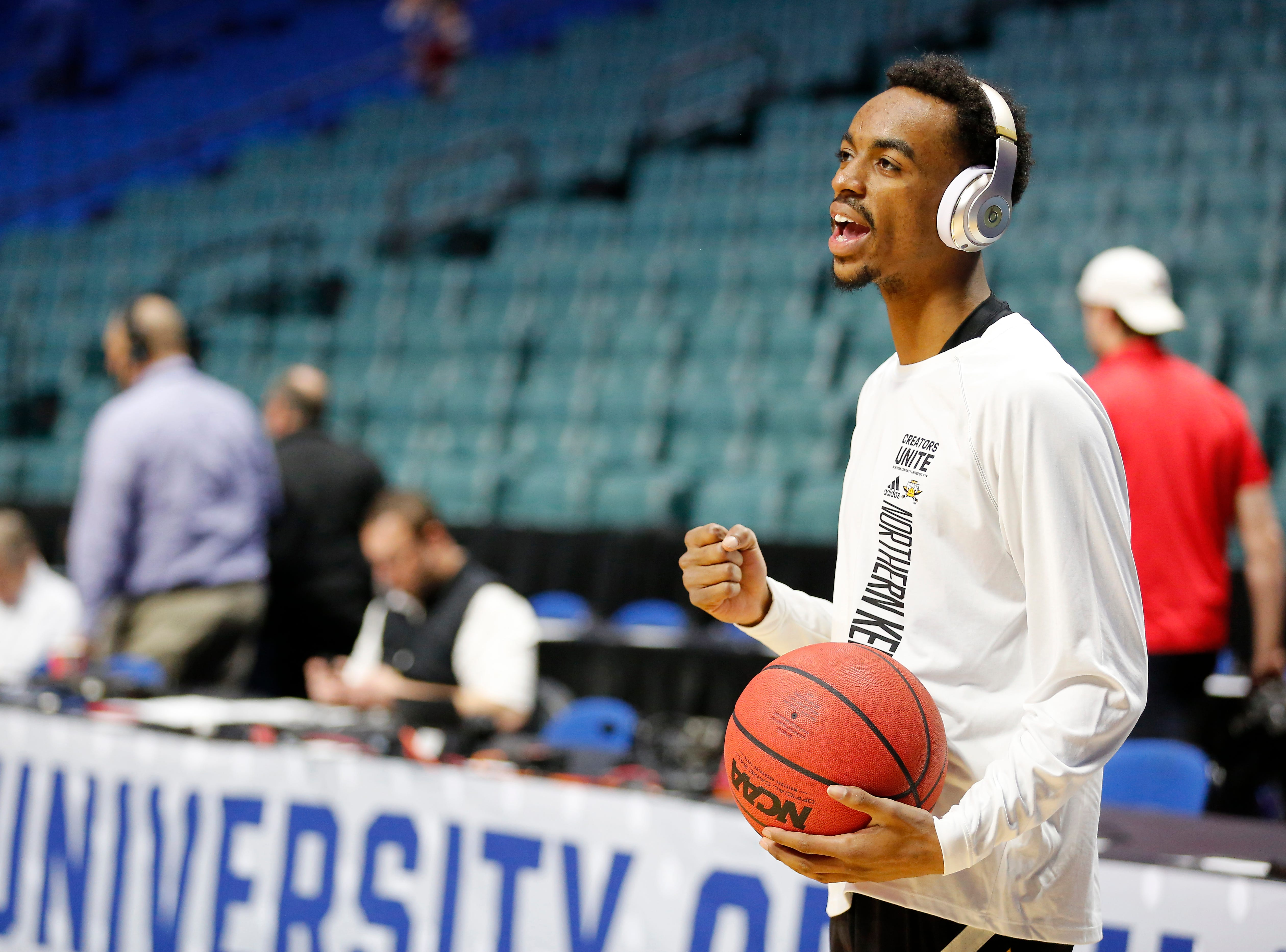 Northern Kentucky Norse guard Jalen Tate (11) listens to music as he warms up during shoot around before the NCAA Tournament First Round game between the 14-seeded Northern Kentucky Norse and the 3-seeded Texas Tech Red Raiders the BOK Center in downtown Tulsa on Friday, March 22, 2019.