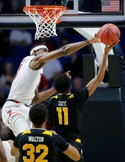 Texas Tech Red Raiders forward Tariq Owens (11) blocks a shot by Northern Kentucky Norse guard Jalen Tate (11) in the second half of the NCAA Tournament First Round game between the 14-seeded Northern Kentucky Norse and the 3-seeded Texas Tech Red Raiders the BOK Center in downtown Tulsa on Friday, March 22, 2019. NKU was knocked from the tournament with a 72-57 loss to the Red Raiders.