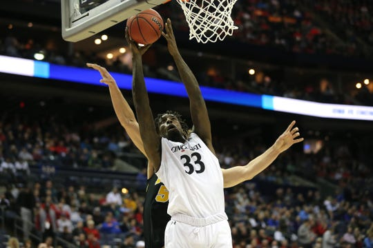 Center Nysier Brooks scores in the first half.