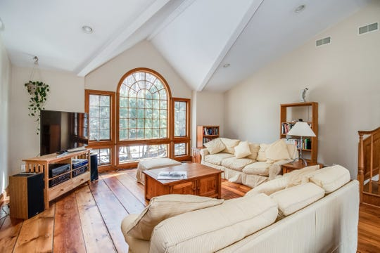 Designed with bold architectural lines and details, a custom contemporary set on 3.44 woodland acres in Clinton Township is for sale for $499,900.
