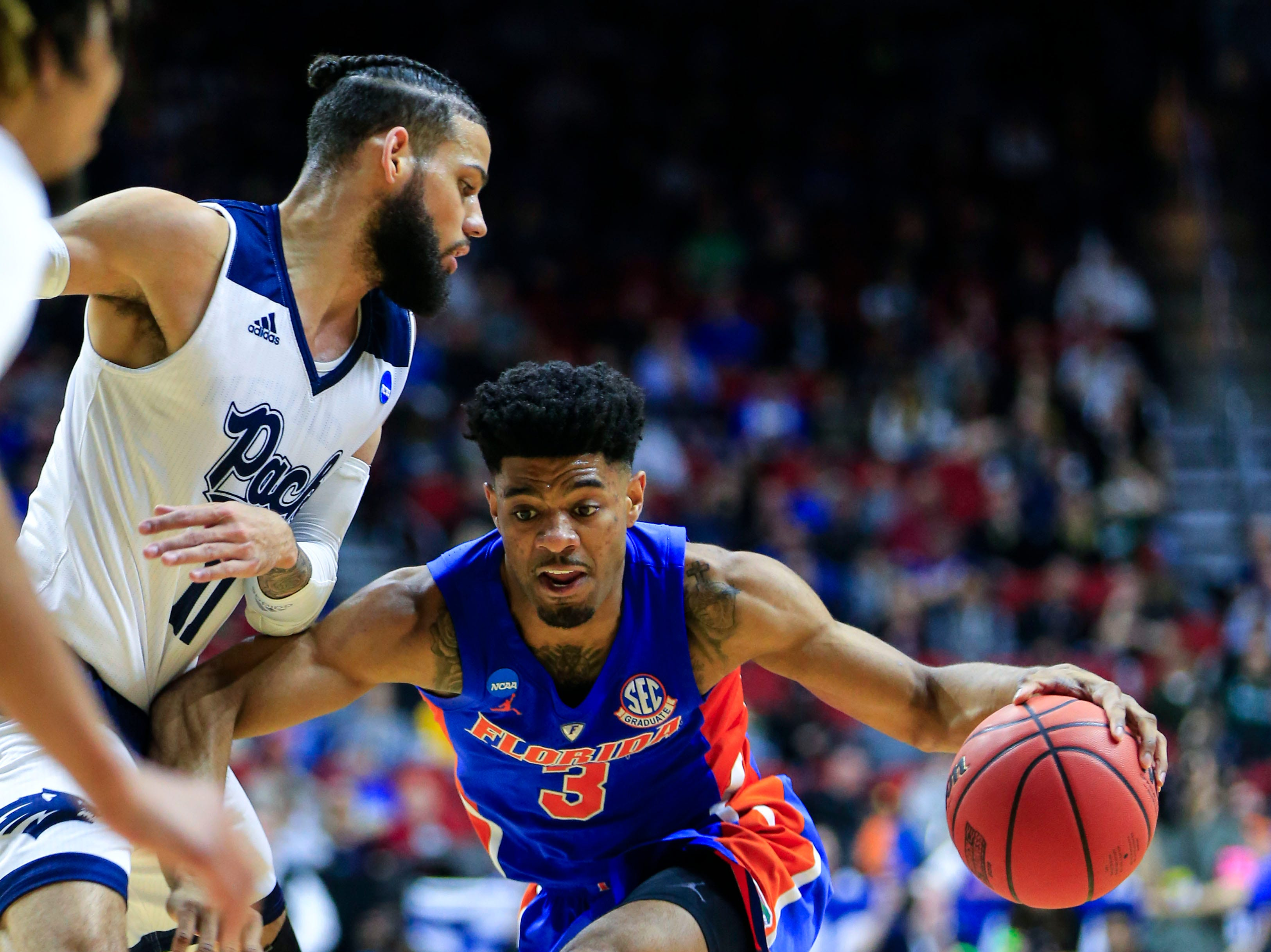 Florida guard Jalen Hudson drives to the basket as Nevada forward Cody Martin defends during their NCAA Division I Men's Basketball Championship First Round game on Thursday, March 21, 2019 in Des Moines.