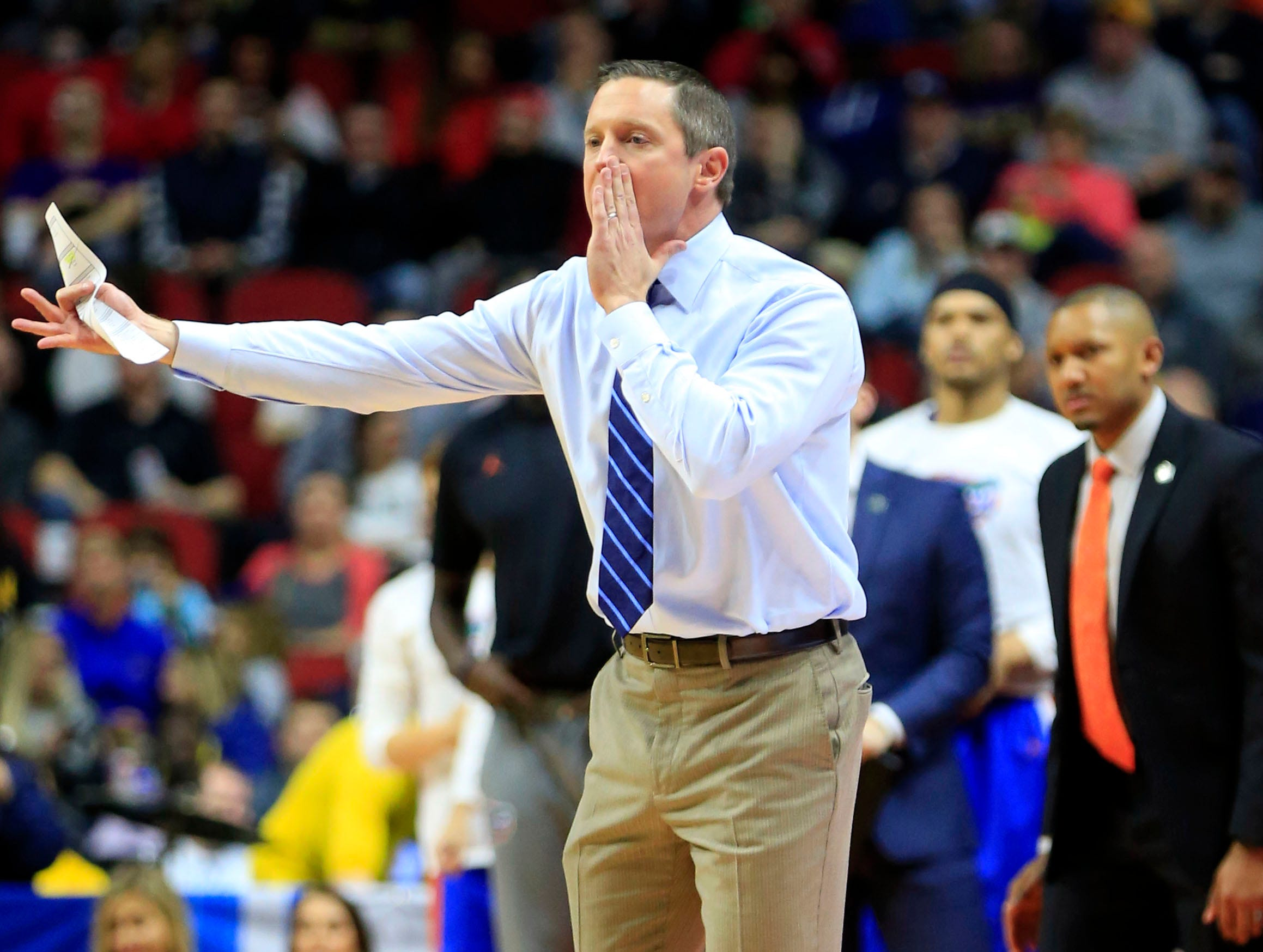 Florida Head Coach Mike White calls a play during their NCAA Division I Men's Basketball Championship First Round game against Nevada on Thursday, March 21, 2019 in Des Moines.