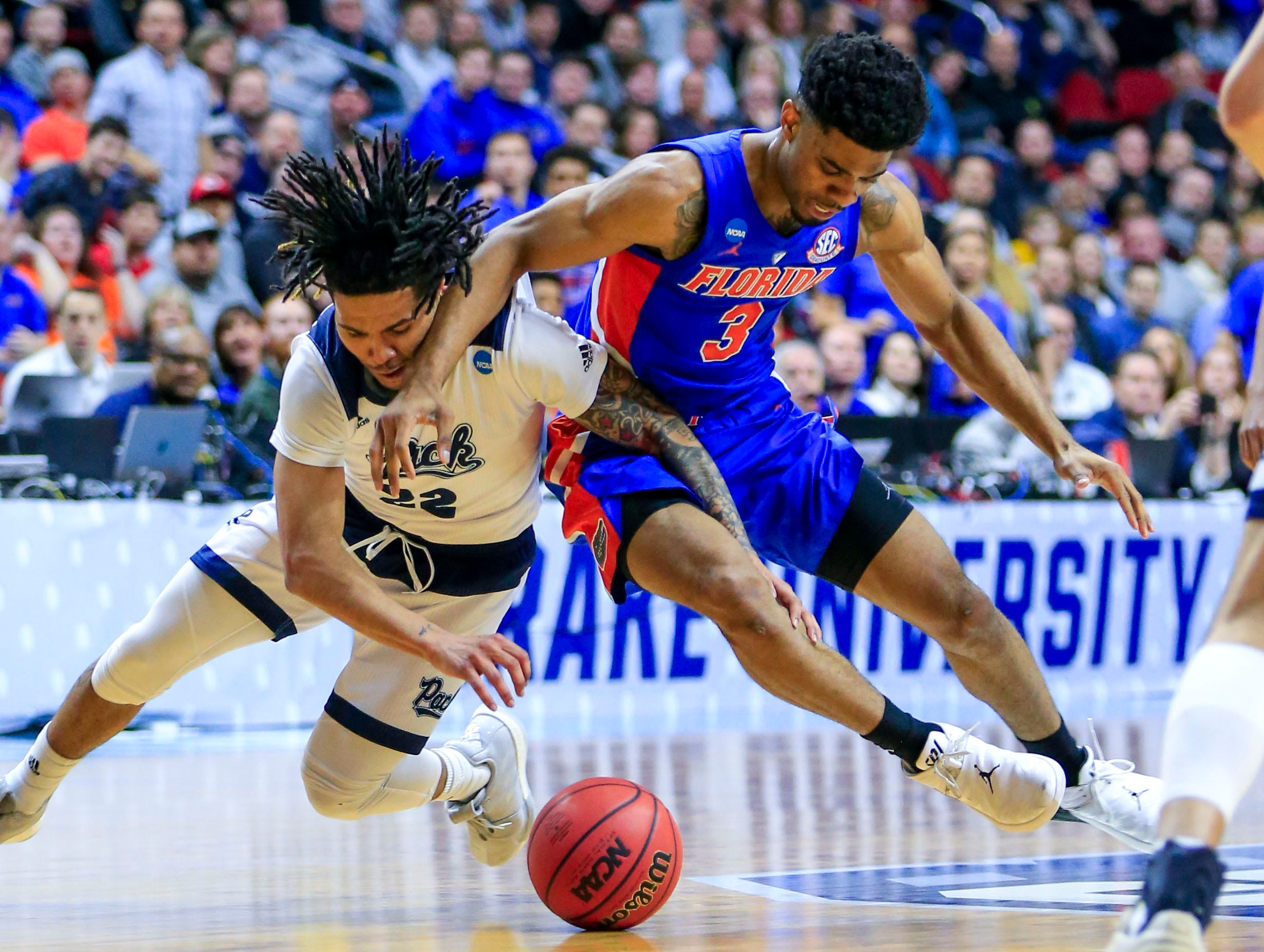 Nevada guard Jazz Johnson and Florida guard Jalen Hudson fight for the ball during their NCAA Division I Men's Basketball Championship First Round game on Thursday, March 21, 2019 in Des Moines.