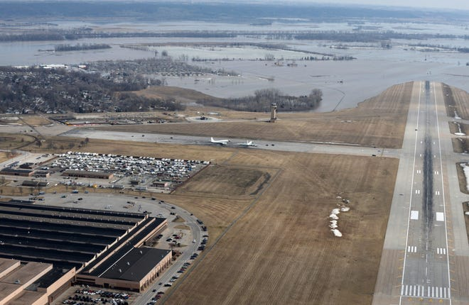 This March 17, 2019 photo released by the U.S. Air Force shows an aerial view of Offutt Air Force Base and the surrounding areas affected by flood waters in Nebraska. The Missouri River floodwaters poured onto much of the Nebraska air base that houses the U.S. Strategic Command, overwhelming the sandbagging by troops and their scramble to save sensitive equipment, munitions and aircraft.