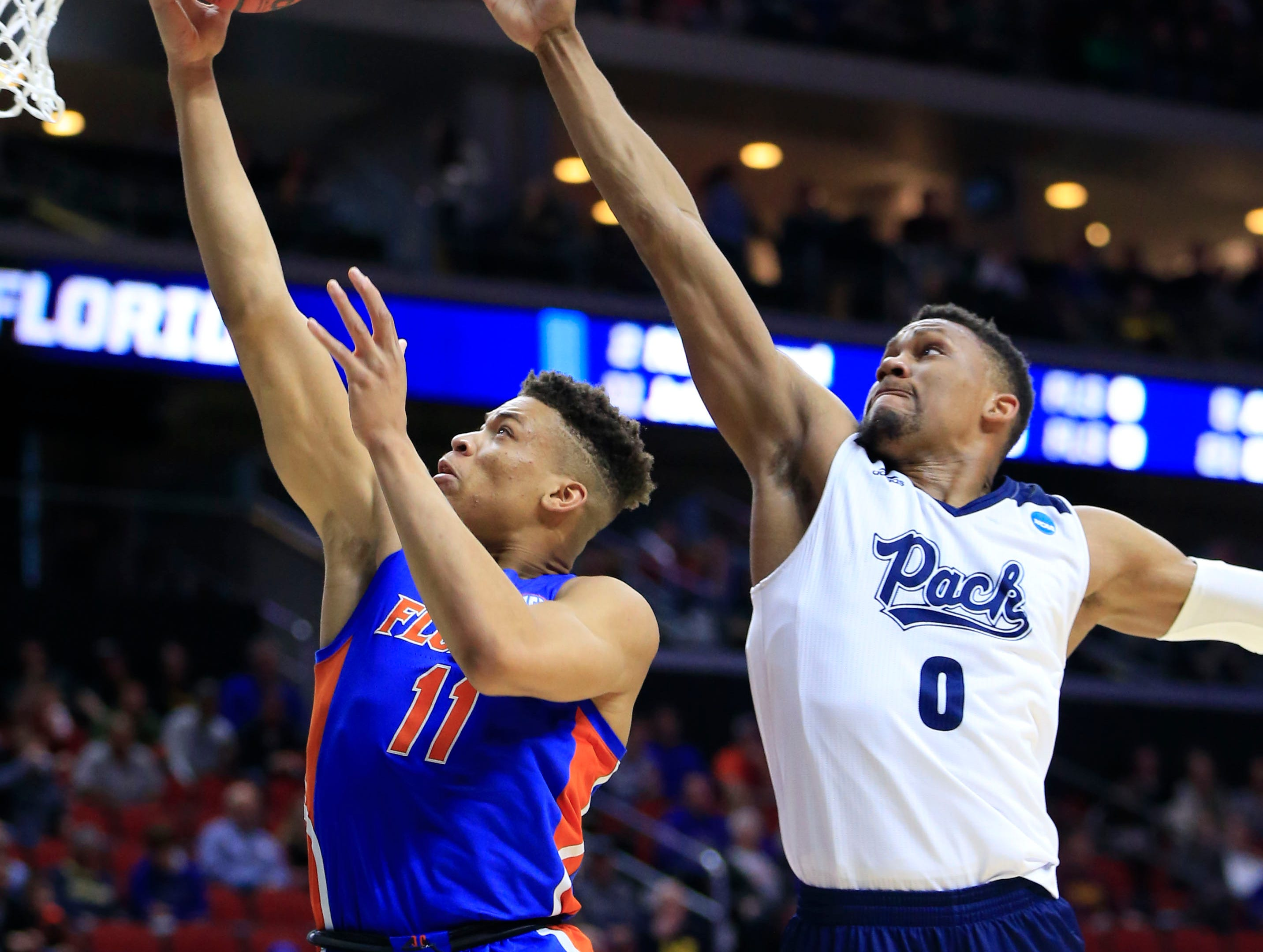 Florida forward Keyontae Johnson drives to the basket as Nevada forward Tre'Shawn Thurman defends during their NCAA Division I Men's Basketball Championship First Round game on Thursday, March 21, 2019 in Des Moines.