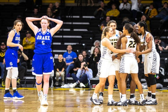 Drake guard Becca Hittner (5) reacts after fouling Missouri guard Jordan Roundtree (22) on a 3-point basket attempt during a NCAA women's basketball tournament first-round game, Friday, March 22, 2019, at Carver-Hawkeye Arena in Iowa City, Iowa.