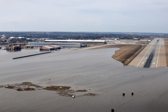 This March 17, 2019 photo released by the U.S. Air Force shows an aerial view of Offutt Air Force Base and the surrounding areas affected by flood waters in Neb. Surging unexpectedly strong and up to 7 feet high, the Missouri River floodwaters that poured on to much the Nebraska air base that houses the U.S. Strategic Command overwhelmed the frantic sandbagging by troops and their scramble to save sensitive equipment, munitions and aircraft.