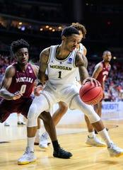 Michigan's Charles Matthews drives to the basket Thursday.