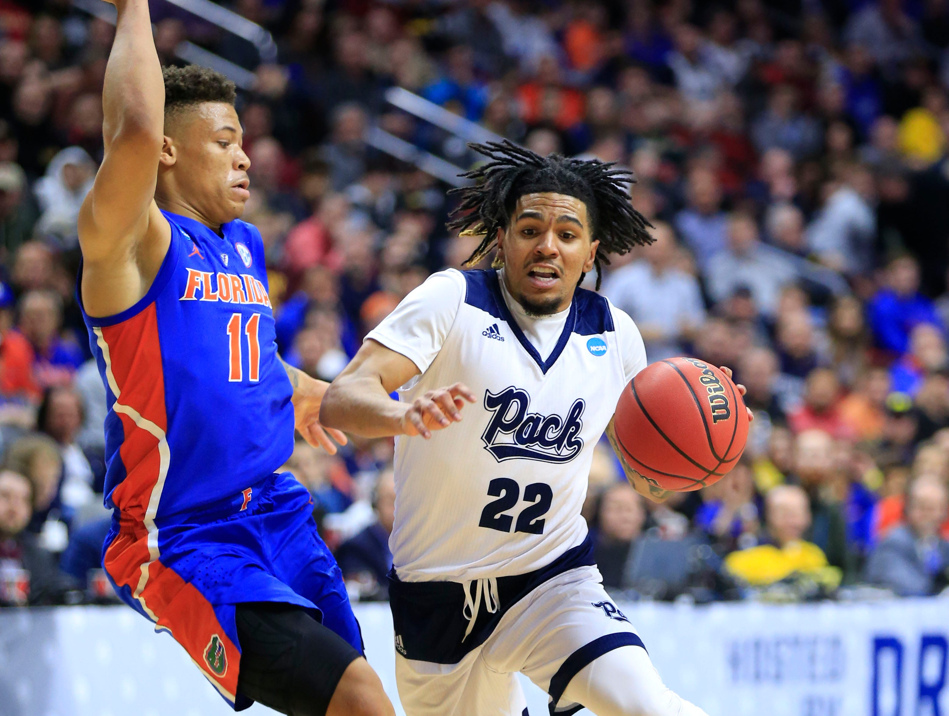 Nevada guard Jazz Johnson drives to the basket as Florida forward Keyontae Johnson defends during their NCAA Division I Men's Basketball Championship First Round game on Thursday, March 21, 2019 in Des Moines.