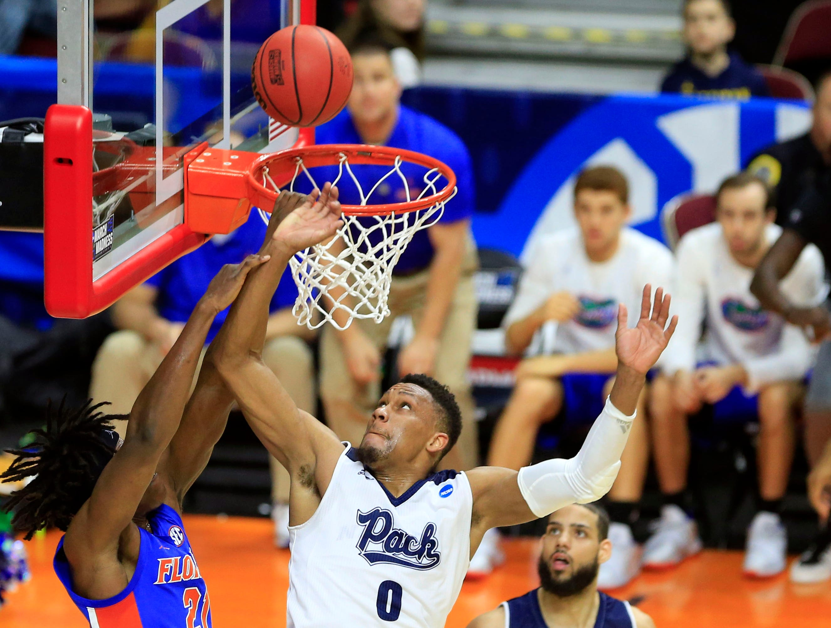 Nevada forward Tre'Shawn Thurman blocks a shot from Florida forward Dontay Bassett during their NCAA Division I Men's Basketball Championship First Round game on Thursday, March 21, 2019 in Des Moines.