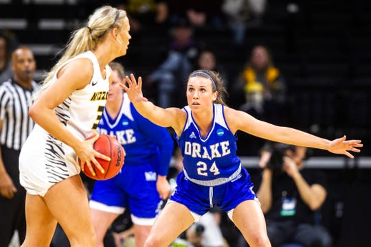 Drake guard Nicole Miller (24) defends Missouri guard Sophie Cunningham (3) during a NCAA women's basketball tournament first-round game, Friday, March 22, 2019, at Carver-Hawkeye Arena in Iowa City, Iowa.