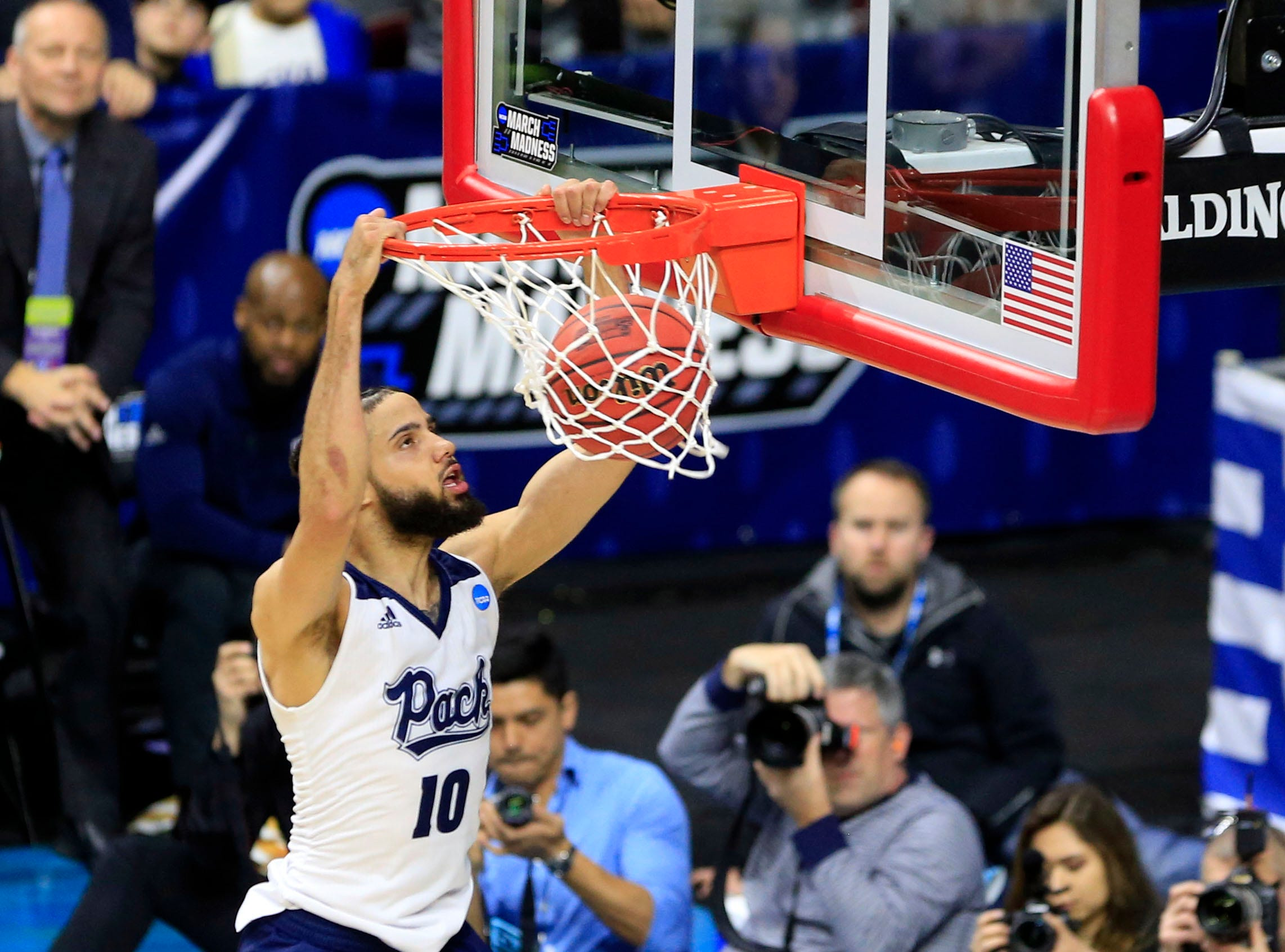 Nevada forward Caleb Martin dunks during their NCAA Division I Men's Basketball Championship First Round game against Florida on Thursday, March 21, 2019 in Des Moines.