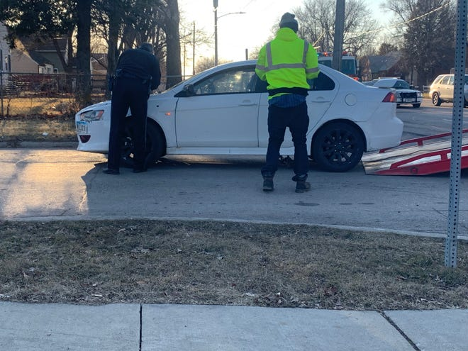 A car apparently involved in a shooting in the 4900 block of Franklin Avenue is towed from near Tower Park on Thursday, March 21, 2019