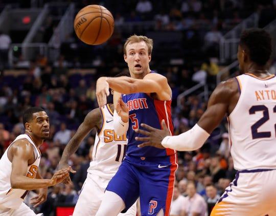 Detroit Pistons guard Luke Kennard passes against the Phoenix Suns during the first half Thursday, March 21, 2019, in Phoenix. (AP Photo/Matt York)