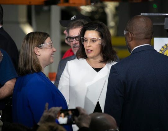 Congresswoman Elissa Slotkin, left, speaks with Governor Gretchen Whitmer before GM CEO Mary Barra announces a $300 million  investment in the Orion Township Assembly Plant Friday, March 22, 2019 that will add 400 jobs for new Chevrolet Electric Vehicle  .