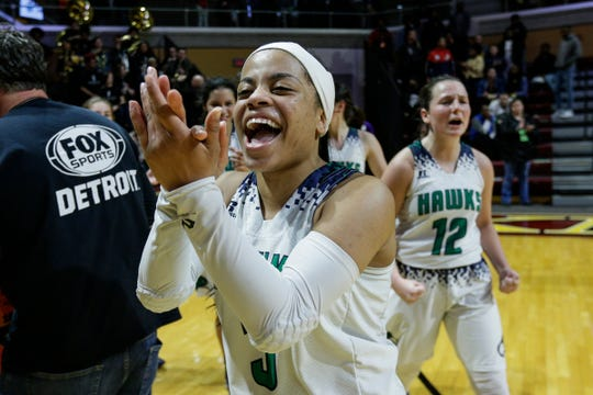 Saginaw Heritage's LoLo Reed (3) celebrates the Hawks' 58-55 win over Wayne Memorial at the MHSAA girls Division 1 semifinal at Van Noord Arena in Grand Rapids, Friday, March 22, 2019.