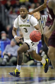 Michigan's Zavier Simpson drives against Montana in the second half of the NCAA tournament Thursday, March 21, 2019 at Wells Fargo Arena in Des Moines, Iowa.