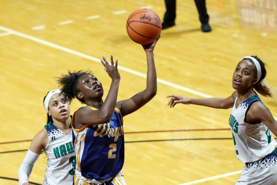 Wayne Memorial's Jordan Wright (2) makes a layup against Saginaw Heritage during the second half of MHSAA girls Division 1 semifinal at Van Noord Arena in Grand Rapids, Friday, March 22, 2019.