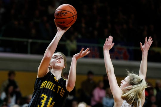 Hamilton's A.J. Ediger (34) makes a layup against Freeland's Kadyn Blanchard (40) during the first half of MHSAA girls Division 2 semifinal at Van Noord Arena in Grand Rapids, Friday, March 22, 2019.