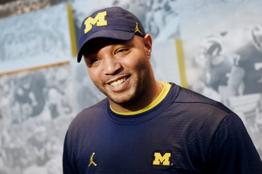 Michigan football offensive coordinator Josh Gattis smiles as he speaks to the media during a news conference at Schembechler Hall on Friday, March 22, 2019.