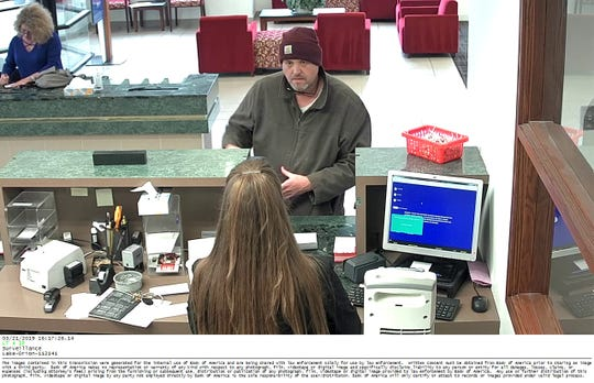 Surveillance image from robbery of Bank of America in Orion Township on March 21, 2019.