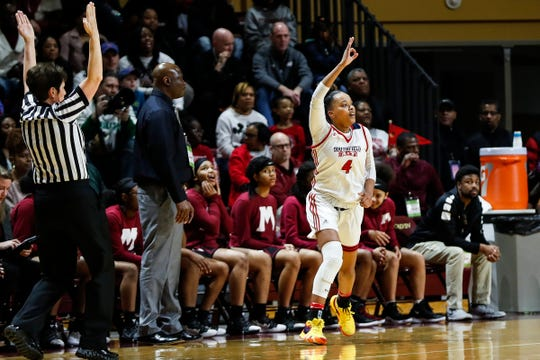 Southfield Arts & Technology's Soleil Barnes (4) celebrates after scoring a 3-point basket Muskegon during the first half of MHSAA girls Division 1 semifinal at Van Noord Arena in Grand Rapids, Friday, March 22, 2019.