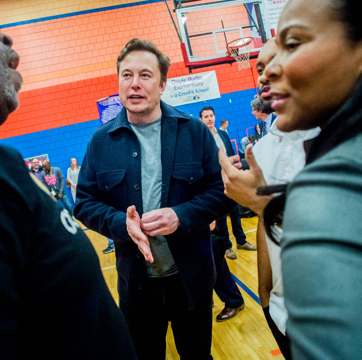 Tesla CEO Elon Musk surprises Flint students with visit, laptops