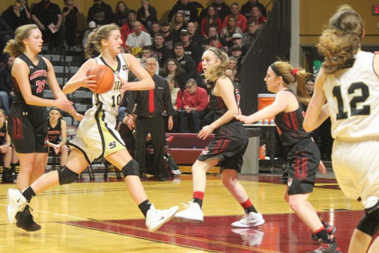Emily Coveyou drives the lane. The St. Ignace senior finished with a game-high 20 points in the Saints' 48-44 win over Kingston.