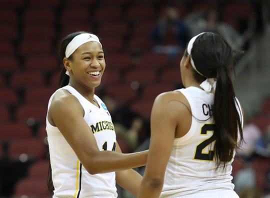 Michigan's Akienreh Johnson, left, and Deja Church celebrate after the Wolverines went on a run forcing Kansas State to call a timeout in the first round of the women's NCAA tournament in Louisville on March 22, 2019.
