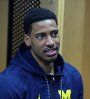 Michigan guard Charles Matthews talks with reporters about their upcoming second round NCAA tournament game against Florida, Friday, March 22, 2019 at Wells Fargo Arena in Des Moines, Iowa.