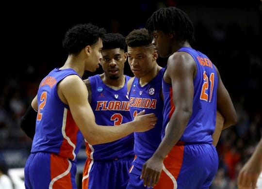 The Florida Gators huddle against Nevada in the second half of the first round of the 2019 NCAA Men's Basketball Tournament at Wells Fargo Arena on March 21, 2019 in Des Moines, Iowa.
