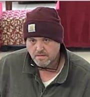 Suspect wanted in robbery of Bank of America in Orion Township on March 21, 2019.