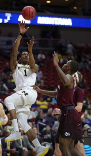 Charles Matthews shoots against Montana in the second half Thursday in Des Moines, Iowa.