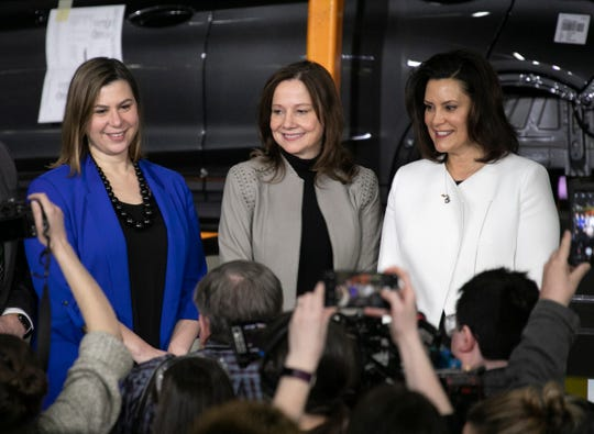U.S Rep. Elissa Slotkin, left, poses with GM CEO Mary Barra and Governor Gretchen Whitmer after Barra announces a $300 million  investment in the Orion Township Assembly Plant Friday, March 22, 2019 that will add 400 jobs for new Chevrolet Electric Vehicle  .