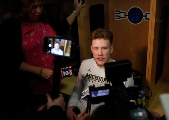 Michigan forward Ignas Brazdeikis talks with reporters about their upcoming second round NCAA tournament game against Florida, Friday, March 22, 2019 at Wells Fargo Arena in Des Moines, Iowa.