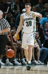 Michigan State University's (30) Tim Bograkos directs his teammates as he brings the ball upcourt  against Loyola University  at the Breslin Center in East Lansing, MI on Tue Dec 17, 2002.