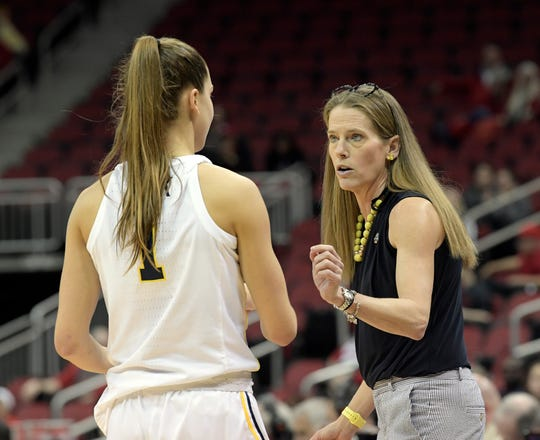 Michigan coach Kim Barnes Arico talks with guard Amy Dilk during the second half of a first-round game against Kansas State in the NCAA women's tournament in Louisville, Ky., Friday, March 22, 2019. Michigan won 84-54.