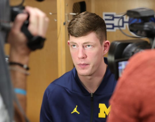 Jon Teske talks with reporters at the 2019 NCAA tournament March 22.