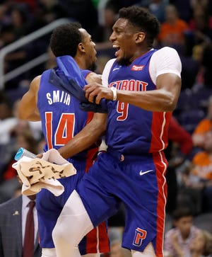 Detroit Pistons guards Ish Smith (14) and Langston Galloway celebrate during the win over the Suns.