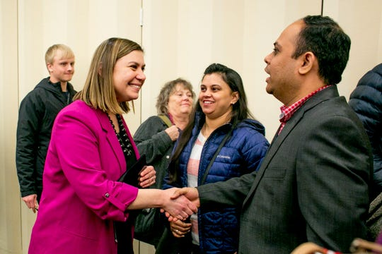U.S. Rep. Elissa Slotkin greets constituents Pooja Sharma and her husband, Manoj Bhalerao, both of Rochester, at a town hall event at Oakland University in Rochester on Thursday, March 21.