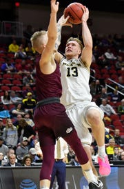"""""""He was a little quite guy actually,"""" says Florida freshman guard Andrew Nembhard of Michigan's Ignas Brazdeikis, right. """"Always confident though, but now he shows it a little more."""""""