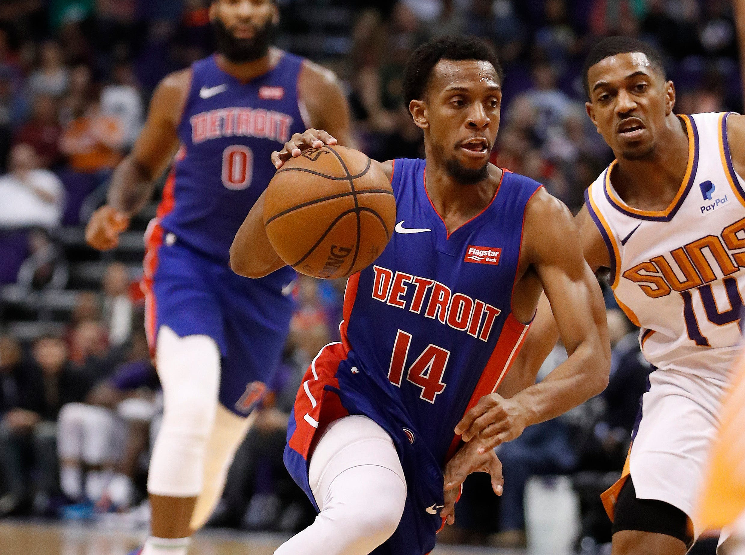 Detroit Pistons guard Ish Smith (14) drives against Phoenix Suns guard De'Anthony Melton (14) during the first half.