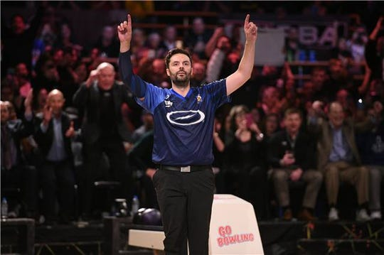 Jason Belmonte celebrates his 11th major championship Thursday.