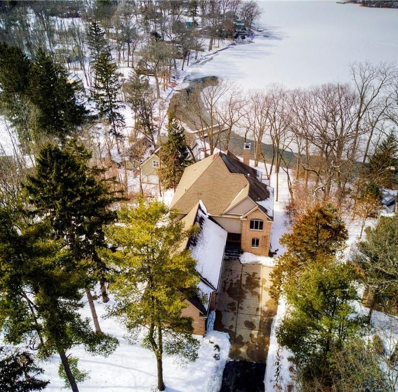MI Dream Home: Custom Cape Cod offers lakefront living near Chelsea