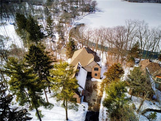 This custom-built Cape Cod near Chelsea, Michigan is listed for $850,000 and features lakefront living near Ann Arbor. The 4,477 square-foot home sits on more than an acre of land on the shores of Crooked Lake and is cradled by the Waterloo State Recreation Area. The home is on a private drive in Sylvan Township, which is about six miles west of Chelsea and about 62.5 miles west of Detroit.